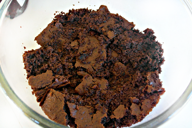 Chocolate cake crumbled in bowl