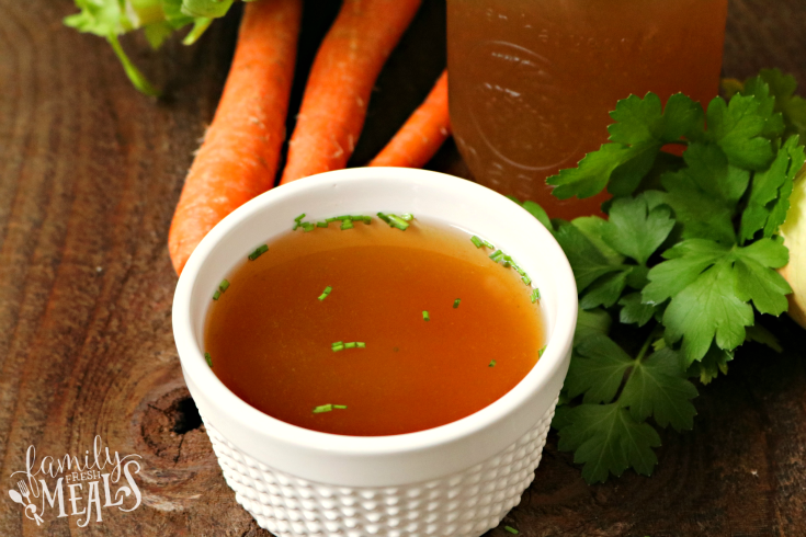 Slow Cooker Bone Broth - Bone Broth made in the crockpot served in a small dish - Family Fresh Meals