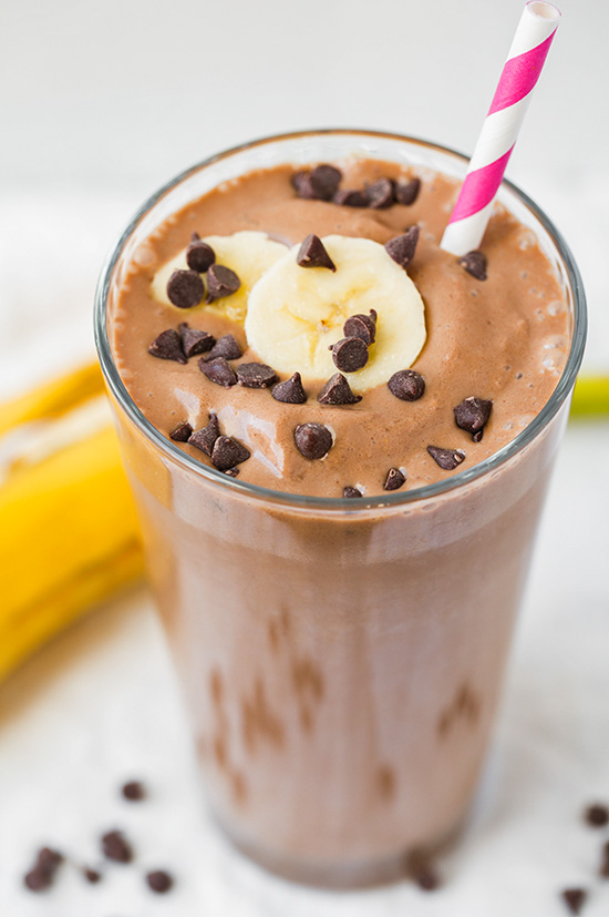 Chocolate Peanut Butter Banana Smoothie topped with mini chocolate chips and banana slice