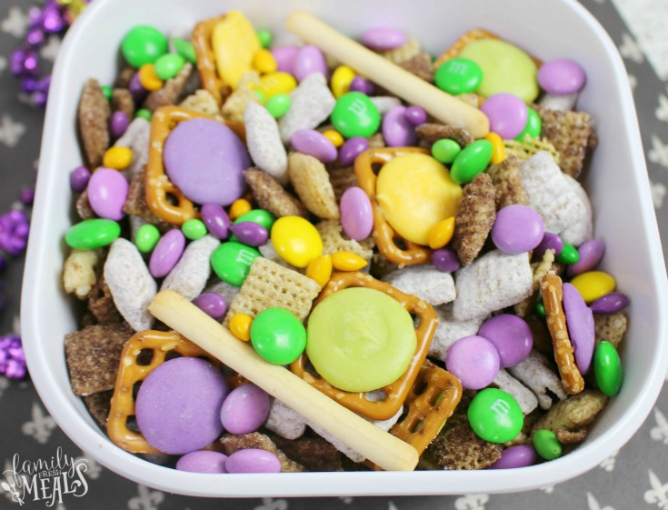 mardi gras snack mix in a white bowl