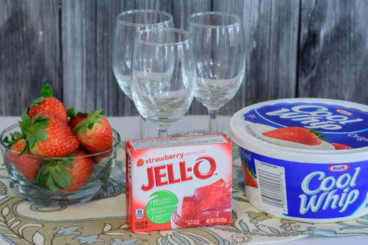 ingredients for jello parfaits and 3 glasses on a table