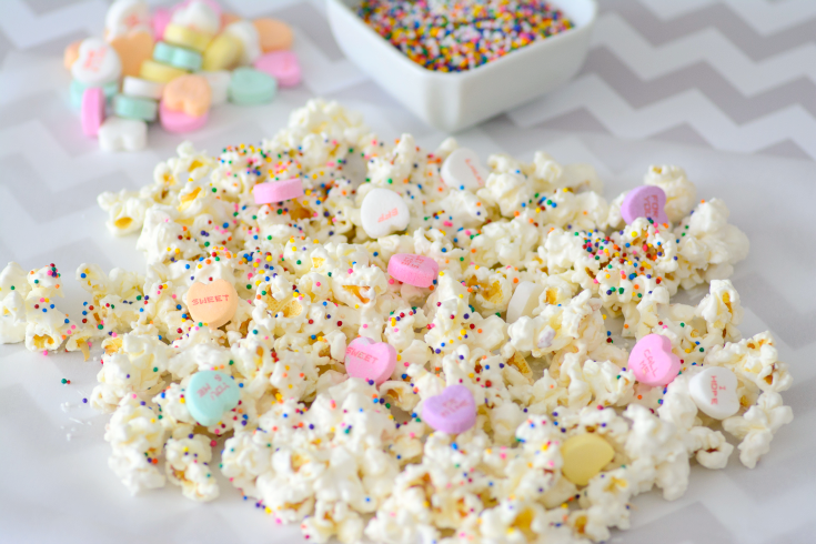 Valentine's Day Popcorn spread out on parchment paper