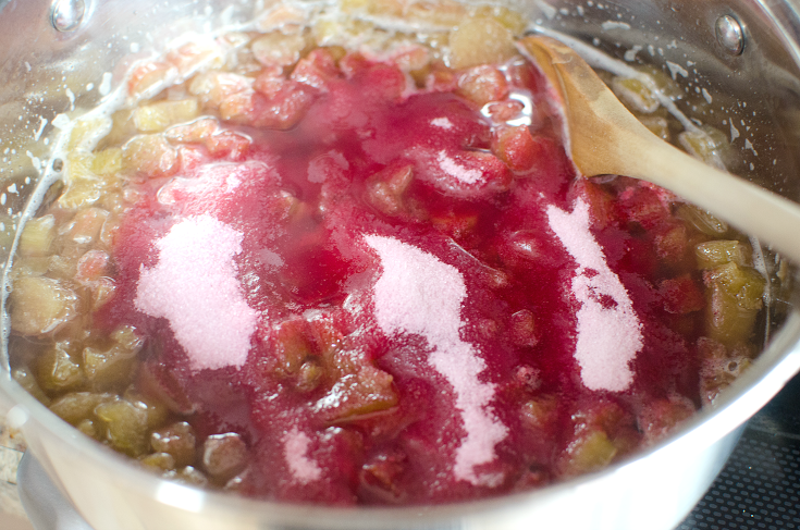 Easy Strawberry Rhubarb Jam - Jello crystals being adding into the sauce pan