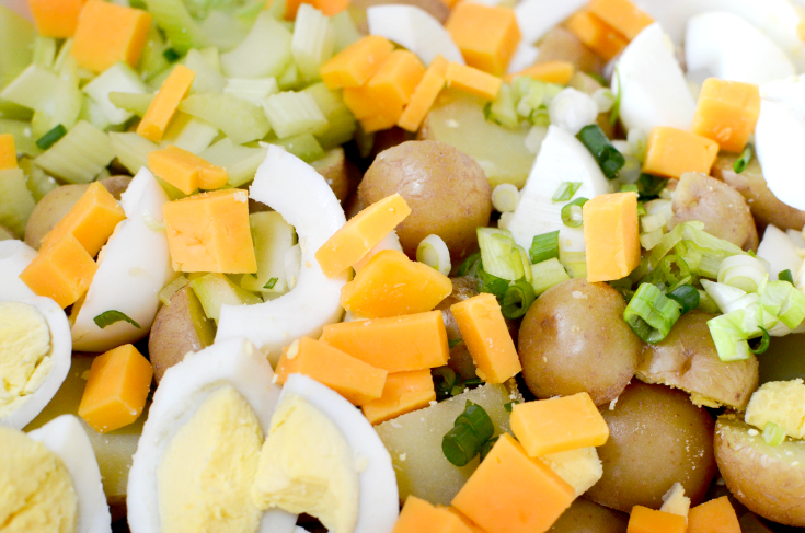 Fully Loaded Potato Salad - mix in cheese hard boiled eggs, celery and onions