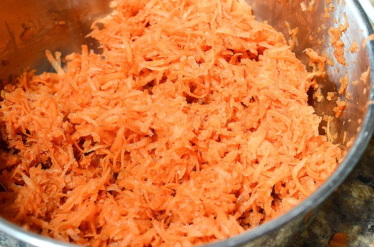 CopyCat Chick Fil A Carrot Raisin Salad Recipe - Shredded carrots in a bowl