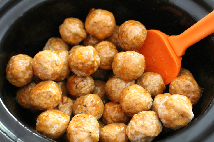 Honey Buffalo Crockpot Meatballs - Stir your slow cooker meatballs