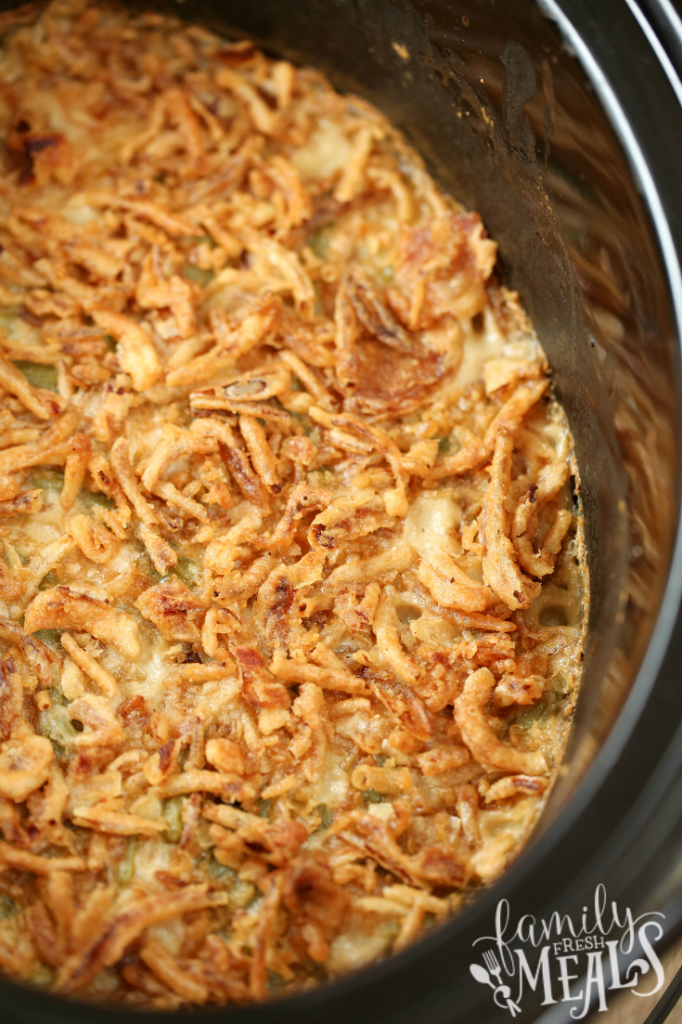 Crockpot Green Bean Casserole cooked in a slow cooker and topped with french onions - Family Fresh Meals