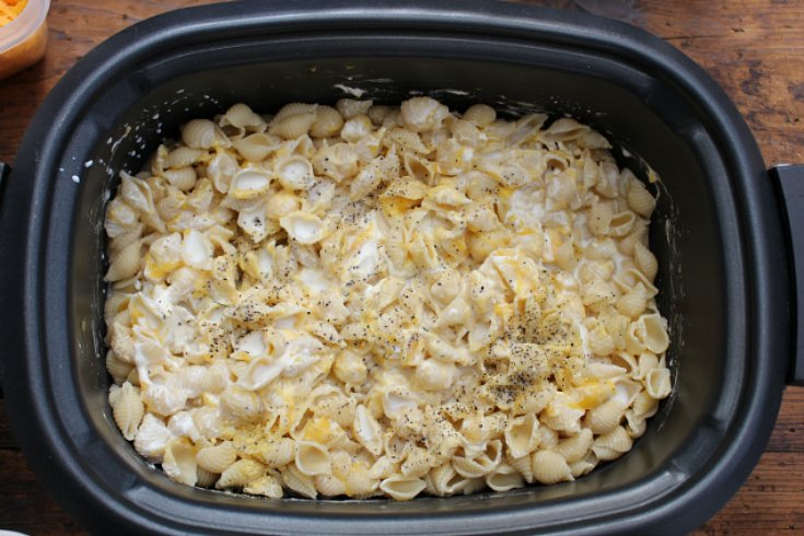 The Best Creamy Crockpot Mac and Cheese - cream soup, milk and seasoning added into slow cooker
