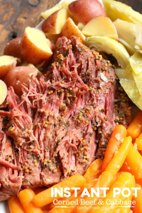 Instant Pot Corned Beef and Cabbage served on a plater
