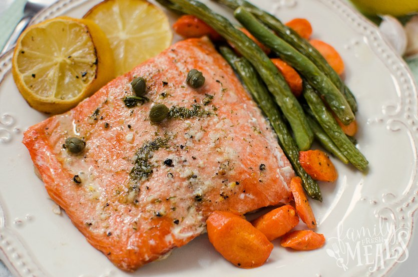Salmon Sheet Pan Dinner - Easy baked salmon recipe served with lemons vegetables