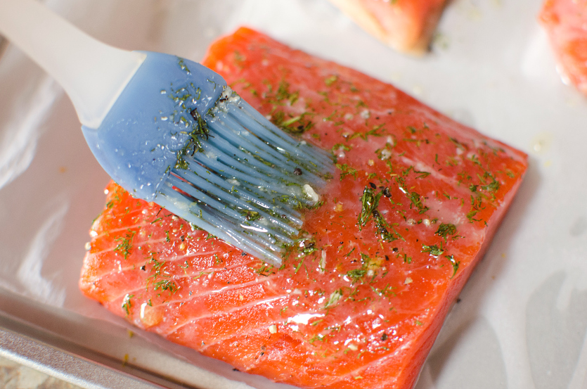 Salmon Sheet Pan Dinner - brush salmon with butter and herbs