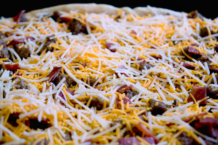 Meat Lovers Breakfast Bake Slab - Shredded cheese and meats placed on top of pie crust