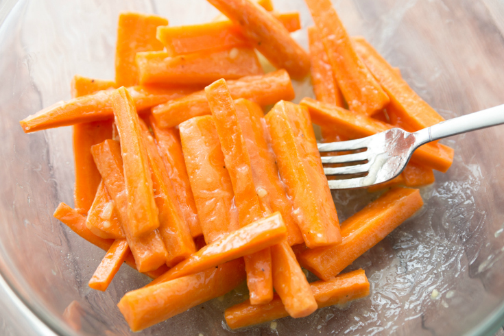 Honey Garlic Roasted Carrots - Carrots in bowl with butter and garlic