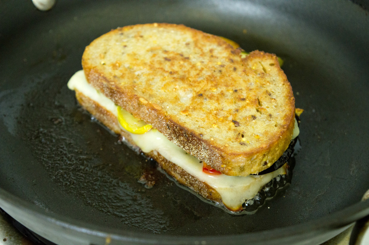 Roasted Vegetable Grilled Cheese - Grilled cheese cooking in pan