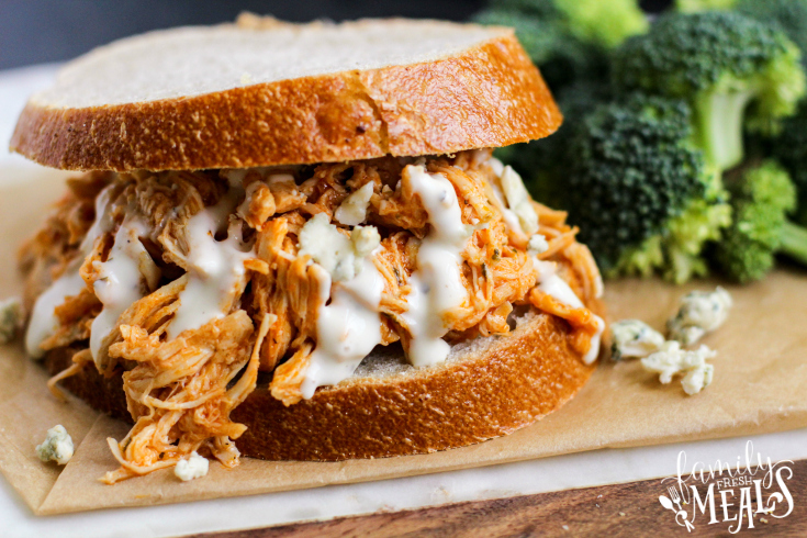 Crockpot Buffalo Chicken Sandwiches - A family favorite sandwich topped with dressing and cheese - Family Fresh Meals