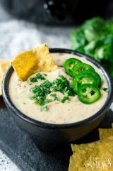 Crockpot White Queso Dip - Dip served in a bowl with chips - Family Fresh Meals