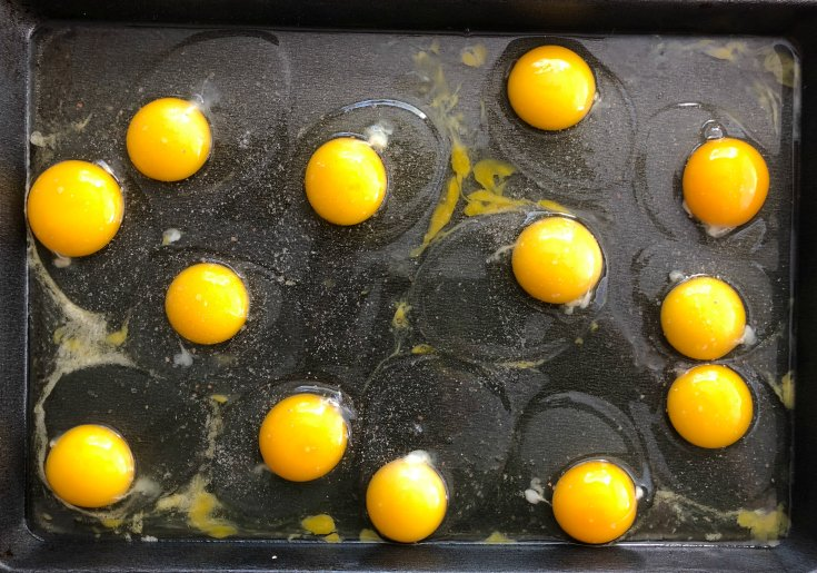 Sheet Pan Eggs - Eggs cracked in pan