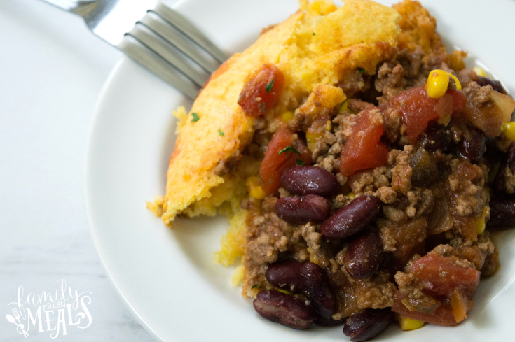 Chili Stuffed Cornbread Casserole - Cassrole served on a white plate