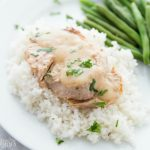 Pork Chops served over rice with a side of green beans
