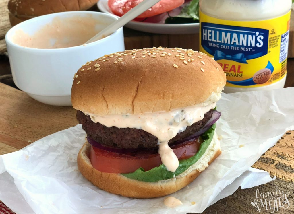 Come Back Burger Sauce Recipe - Hamburger on parchment paper with sauce dripping down the side.
