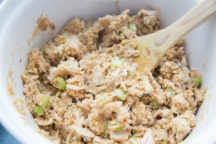 Easy Tuna Patties - ingredients mixed in a white bowl with a wooden spoon