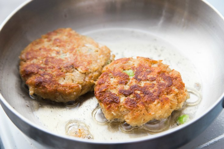Easy Tuna Patties - tuna patties cooking in a frying pan