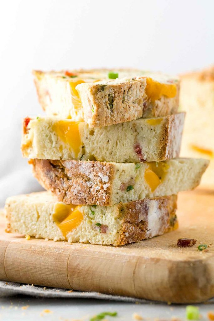 Bacon cheddar irish soda bread - stacked on a cutter board