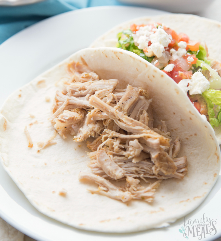 Crockpot Citrus Pork Street Tacos - Shredded pork in a flour tortilla
