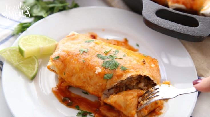 One Pan Smothered Beef Burrito Skillet - Cutting a bite into the burrito with a fork
