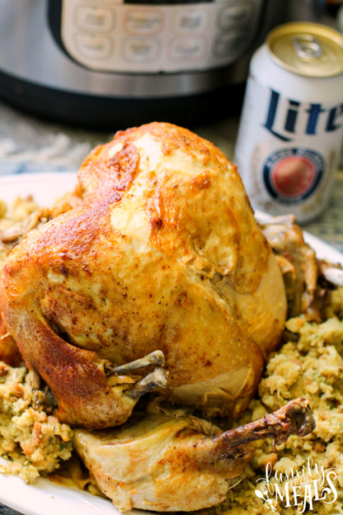 Instant Pot Beer Can Chicken - Beer Can Chicken served on a plate with stuffing