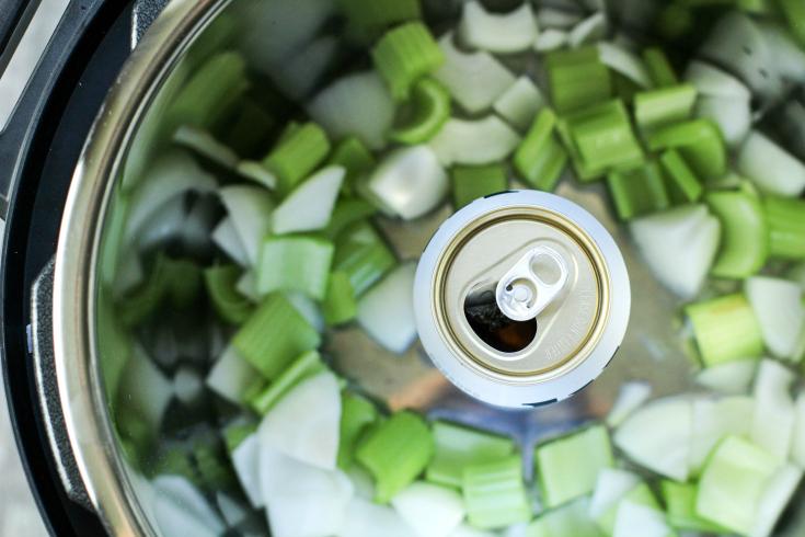 Instant Pot Beer Can Chicken - Beer can, celery, onion and beer can inside the instant pot