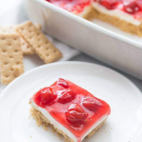 No Bake Cherry Cheesecake Dessert Recipe - Family Fresh Meals Slice of dessert on a white plate