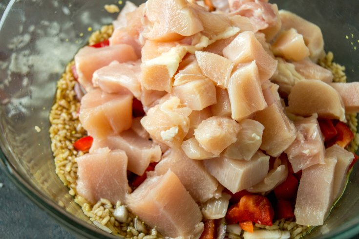 Aloha Pineapple Chicken Rice Casserole - diced chicken, rice, soy sauce, peppers, onion, sugar and chicken broth in a large glass bowl