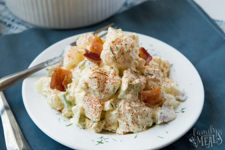 Cauliflower Potato Salad served in a white bowl