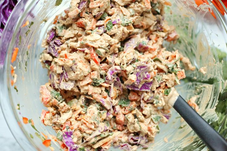 Creamy Thai Chicken Salad - chicken salad mixed in a glass bowl