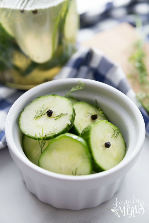Easy Refrigerator Pickles - Cucumber pickles served in a small white bowl