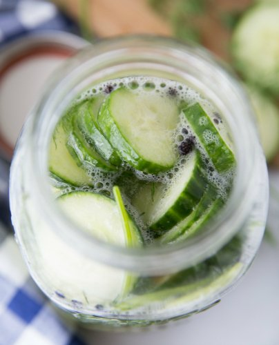 Easy Refrigerator Pickles - sliced cucumber in mason jar