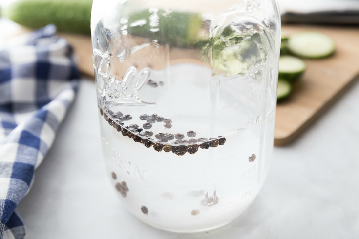 Easy Refrigerator Pickles - vinegar, pepper corns and seasoning in a mason jar
