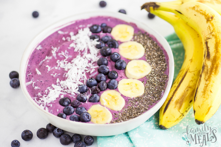 Blueberry Muffin Smoothie Bowl Recipe - Served in a white bowl with banana on the side - Family Fresh Meals