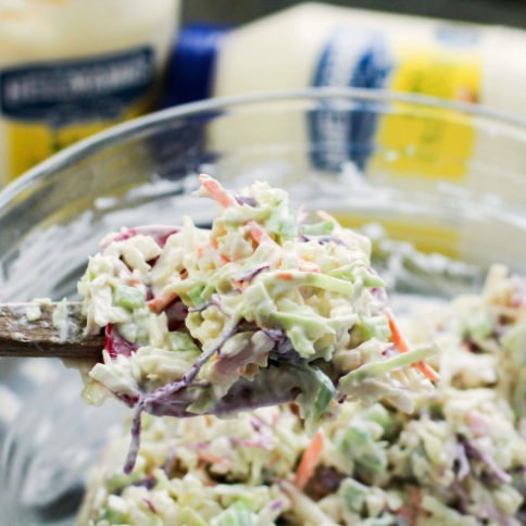 Classic Creamy Cole Slaw - cole slaw mixed up with a wooded spoon - family fresh meals
