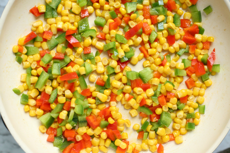 Enchilada Orzo Recipe - corn and bell peppers sauting in a pan