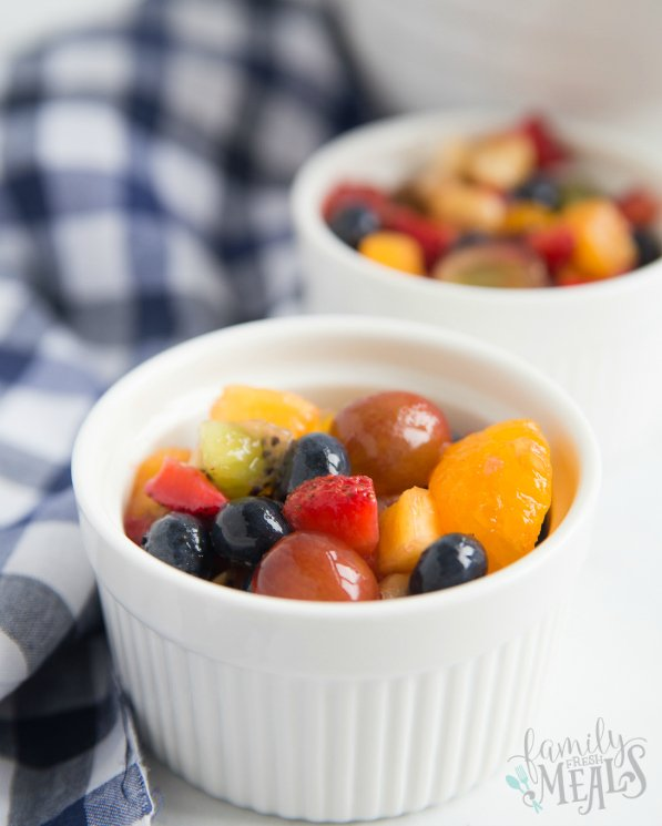 Honey Glazed Fruit Salad Recipe - served in small white bowls - Family Fresh Meals