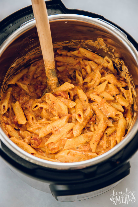 Instant Pot Three Cheese Ziti - Pasta stirred in an instant pot