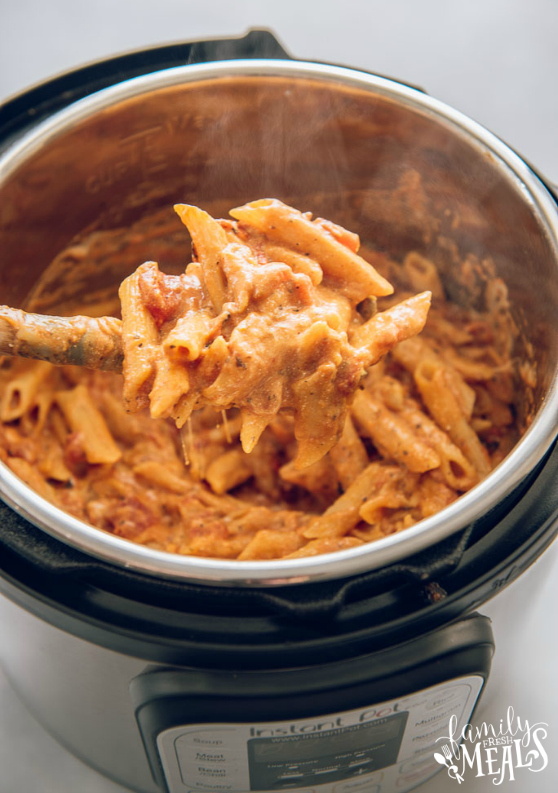 Instant Pot Three Cheese Ziti Recipe - Pasta scooped up with a wooden spoon