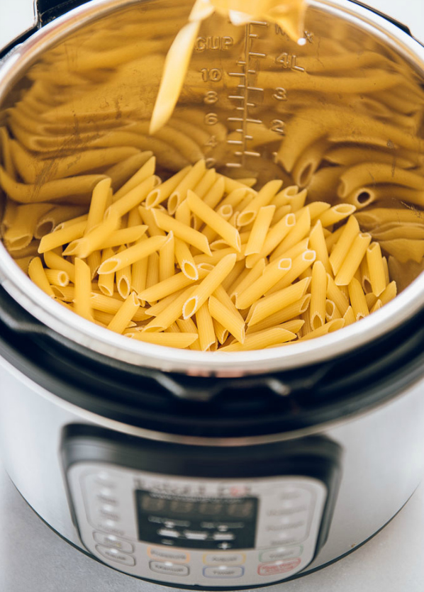 Instant Pot Three Cheese Ziti - Uncooked noodles inside instant pot pressure cooker