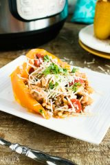 Instant Pot Orzo Sausage Stuffed Peppers Recipe - Served on a white plate