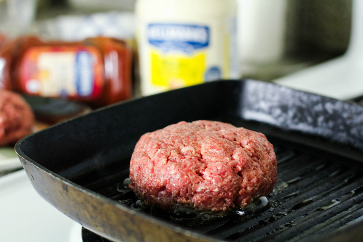 The Best Burgers Recipe - burger cooking on a griddle pan - Family Fresh Meals