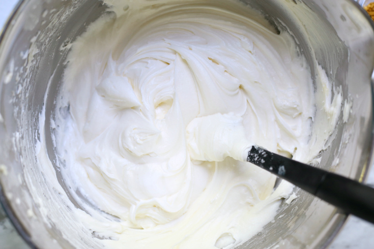UnicornCerealBars - Buttercream frosting being mixed in a mixing bowl