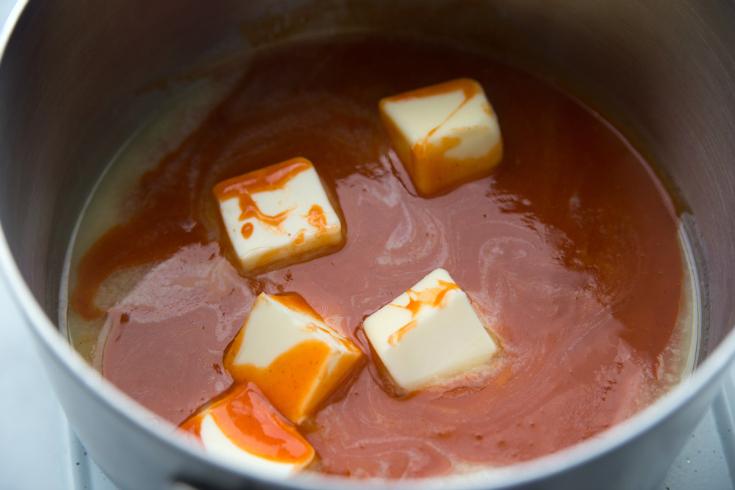 Buffalo Ranch Crack Pretzels - Buffalo sauce and butter in a sauce pan