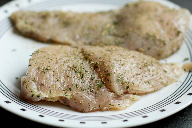 Easy Bruschetta Chicken - Raw chicken on a white plate